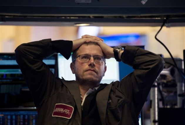 Traders à la cloture sur le New York Stock Exchange le 5 février 2018- Bryan R. Smith