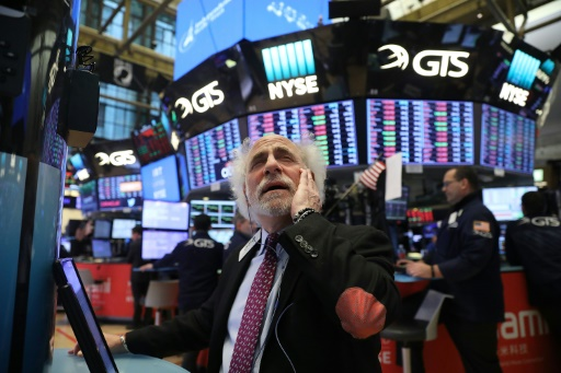 Wall Street, inquiète d'un bras de fer commercial, finit en baisse
