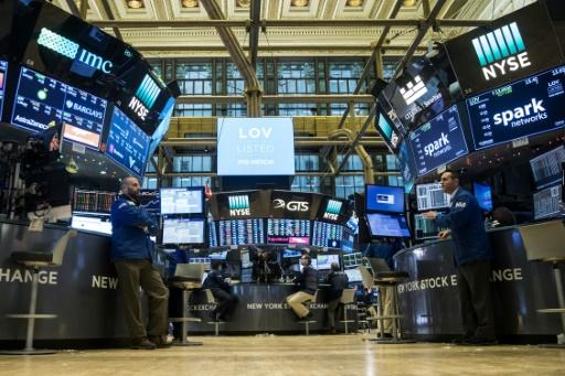 Wall Street recule à la clôture après une hausse de taux de la Fed