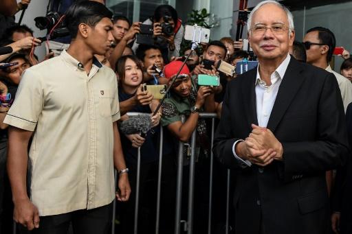 Malaisie: près de 30 millions de dollars saisis chez l'ex-Premier ministre