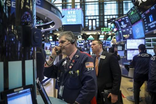 Wall Street, reprenant son souffle, progresse légèrement
