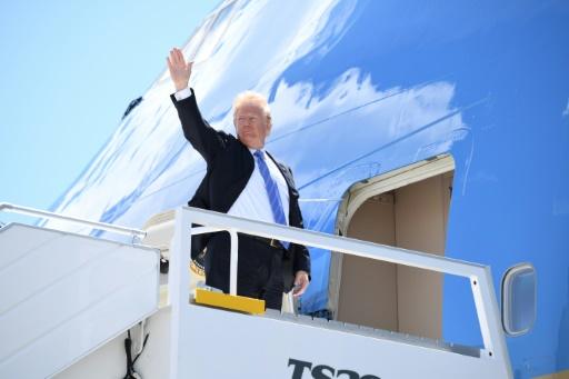 Trump optimiste, en route pour son sommet avec Kim
