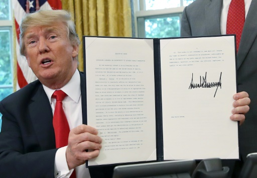 Trump signe un décret visant à mettre fin aux séparations des familles à la frontière