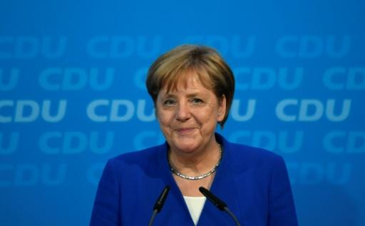 Migrants: Merkel trouve un accord pour sauver son gouvernement