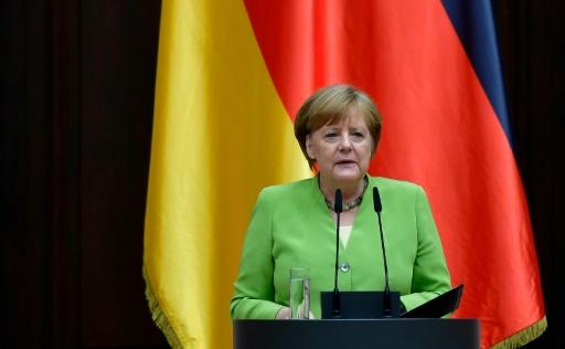 Automobile: Merkel met Trump en garde contre une