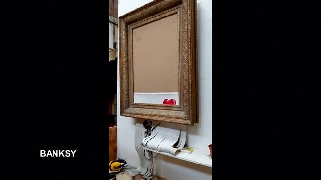 VIDEO : Banksy dévoile que son oeuvre devait normalement TOTALEMENT se déchiqueter!