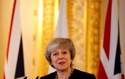 Theresa May appelle le Royaume-Uni à surmonter ses divisions sur le Brexit