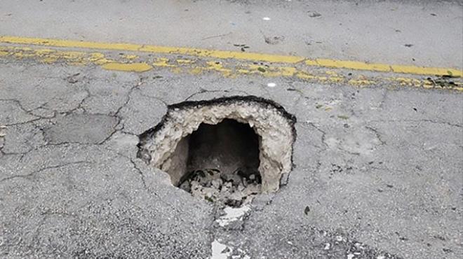 Découverte surprenante aux Etats-Unis: sous le nid de poule, un tunnel mène vers la banque