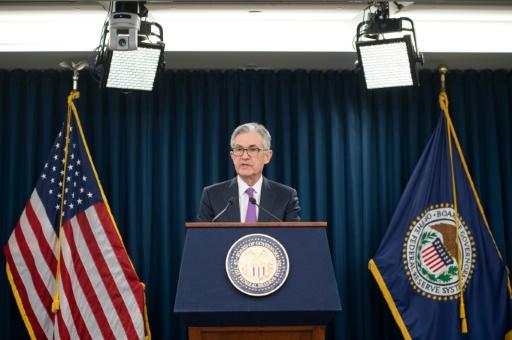 Croissance plus lente, bras de fer commercial: la Fed préfère être