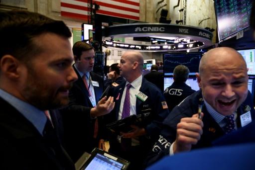 Wall Street termine en hausse, rassurée par le commerce et les taux d'intérêt