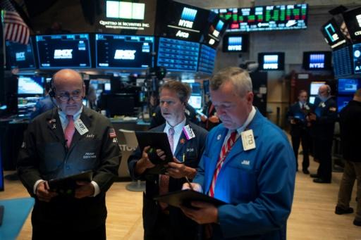 Wall Street finit en ordre dispersé, fébrile à l'approche du G20