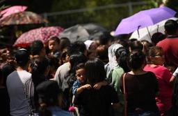 Salvador: funérailles du migrant et de sa fillette morts noyés dans le Rio Bravo