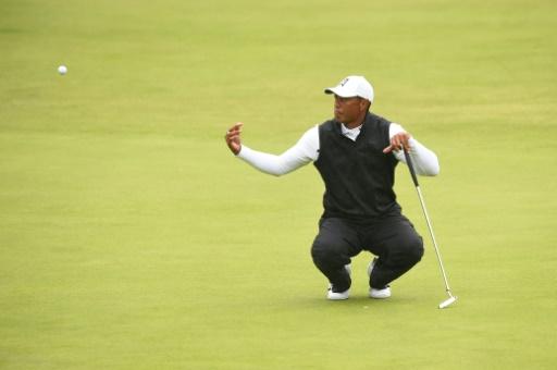 British Open: Holmes rejoint en tête par Lowry, Woods et McIlroy éliminés