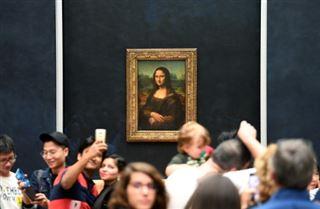 Au Louvre, la Joconde retrouve sa place dans une Salle des Etats bleu nuit