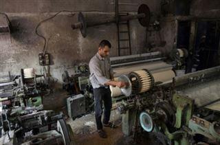 A Alep, la reprise industrielle ralentie par les coupures draconiennes